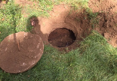 Septic Tank Uncovered and Ready to Pump - Click for Septic Tank Pumping, Installation and Repair