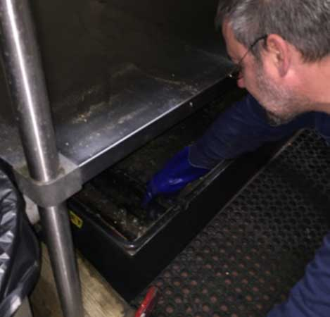Herring Sanitation Employee Cleaning Out Commercial Grease Trap During Normal Service Visit  - Herring Septic - Dutchess County - Putnam County - Orange County - Ulster County